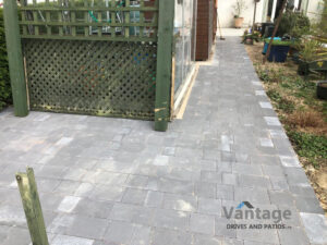 Tegula and Porcelain Slabbed Patio and Pathway in Ongar