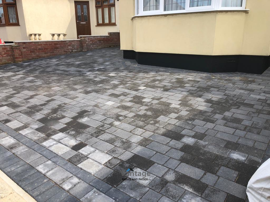 Tegula Paved Driveway and Patio with Flower Beds and Artificial Lawn in Chelmsford